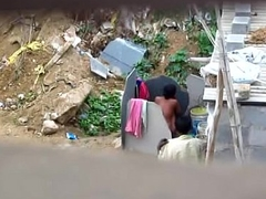 Indian sweeping flushing outdoors